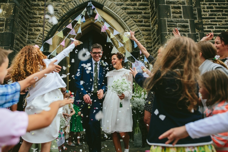 Couple with confetti outside a Lancashire church