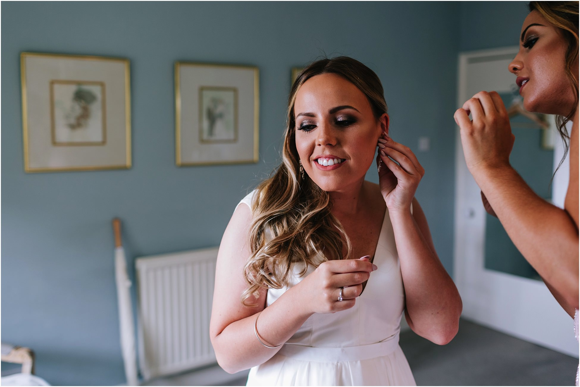 Bride puts her earrings on