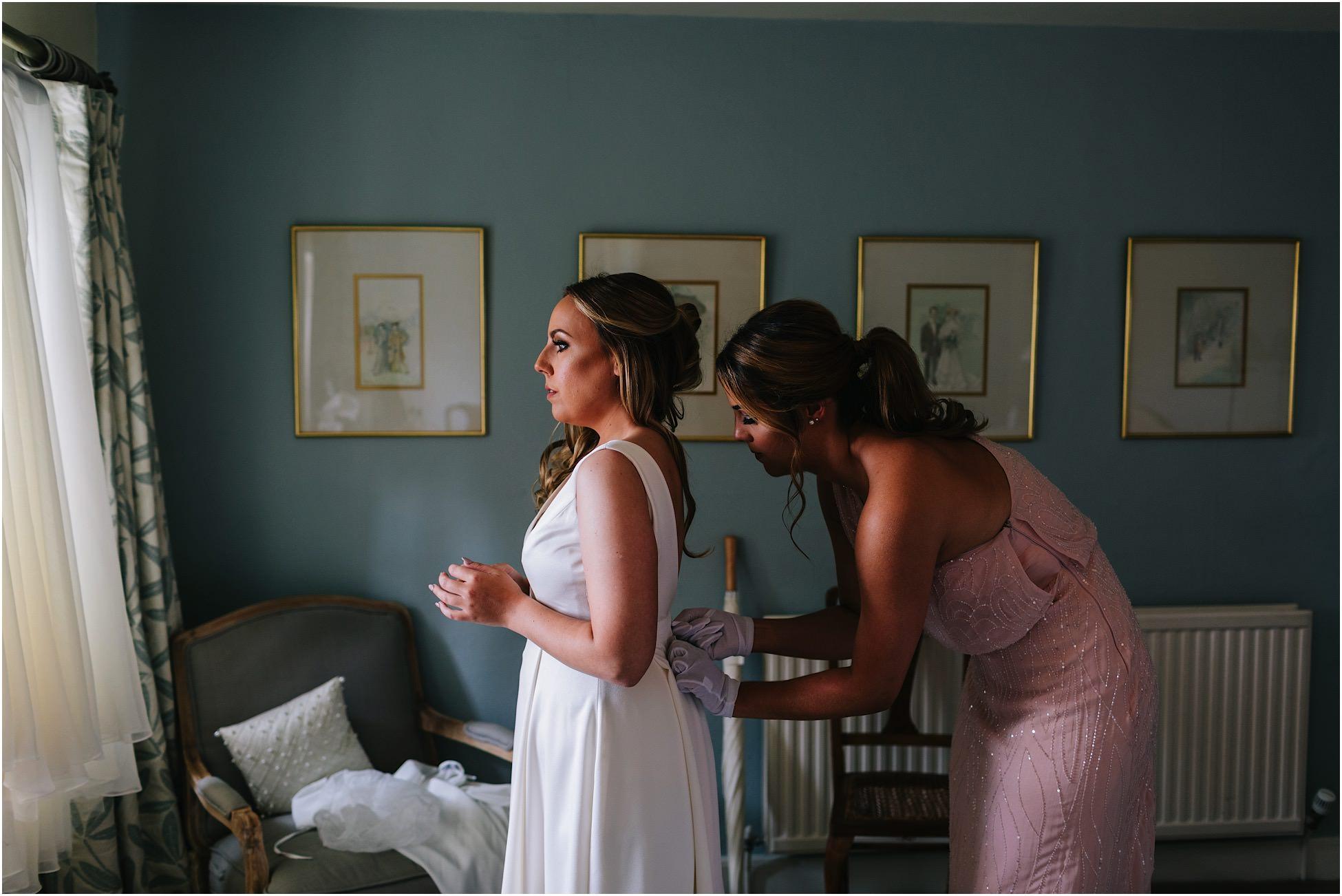 Nervous bride gets her dress on