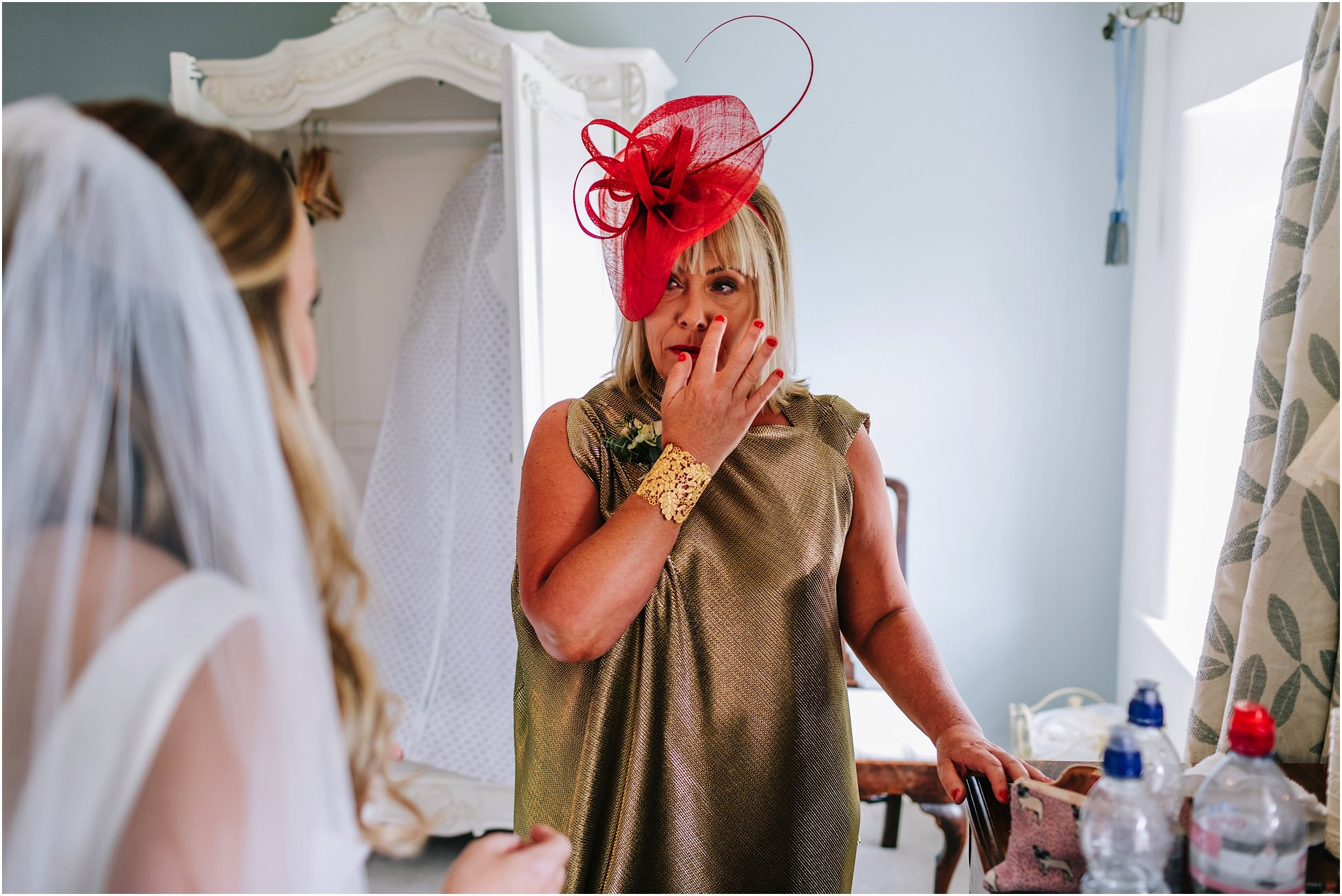 Bride's mum wipes a tear from her eye at a Belmount Hall wedding