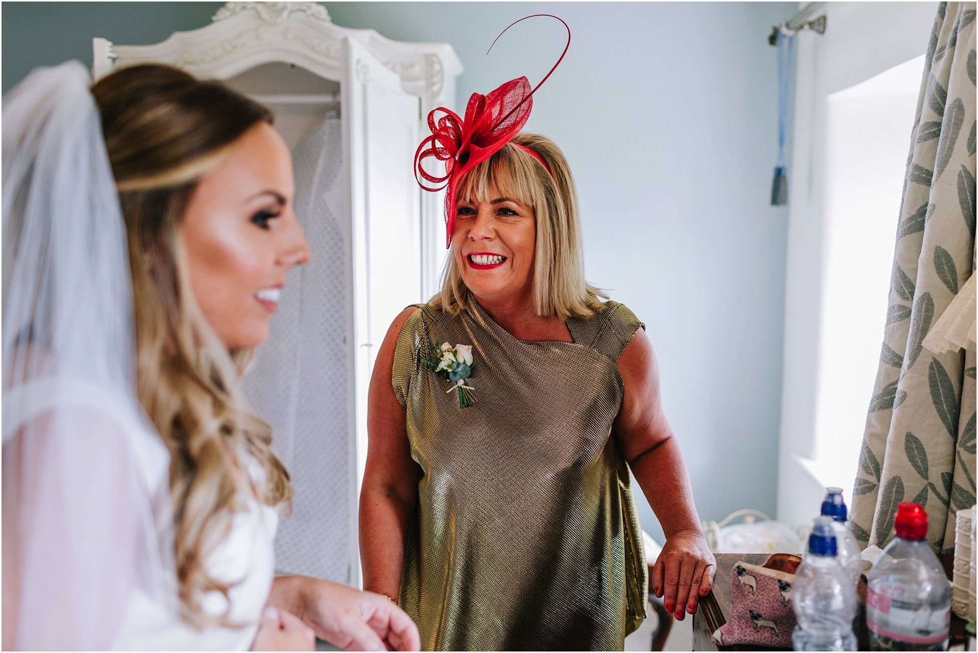 Mother of the bride smiles at her daughter