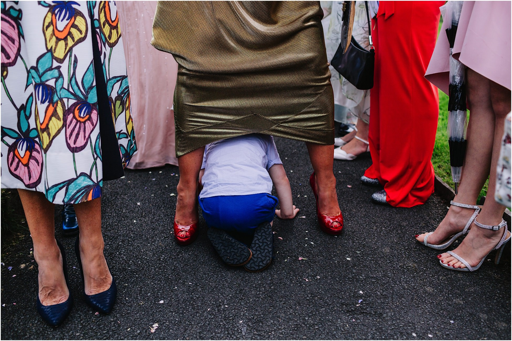 Belmount Hall wedding - a little boy crawls through legs
