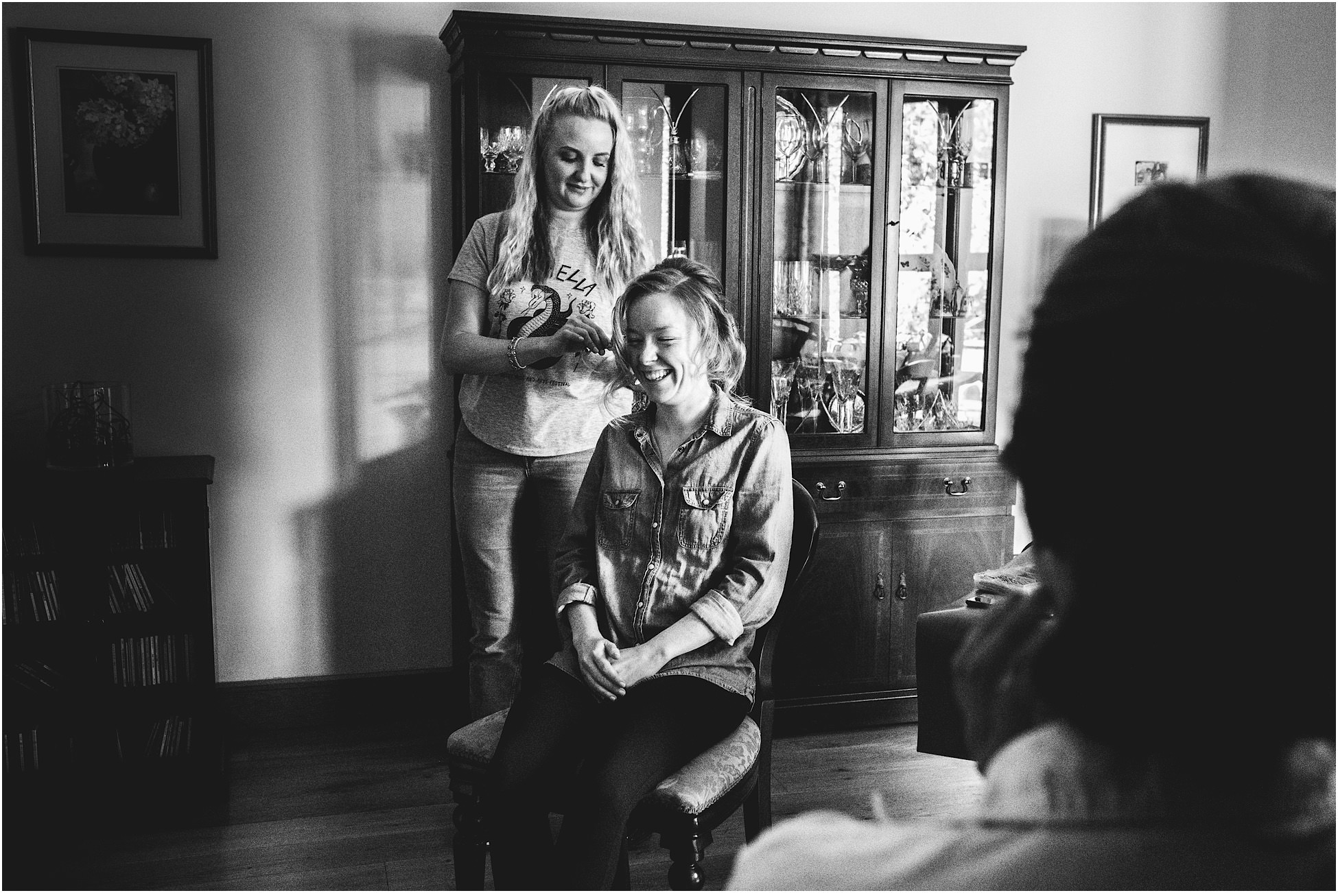 Bride laughing as she gets her makeup done