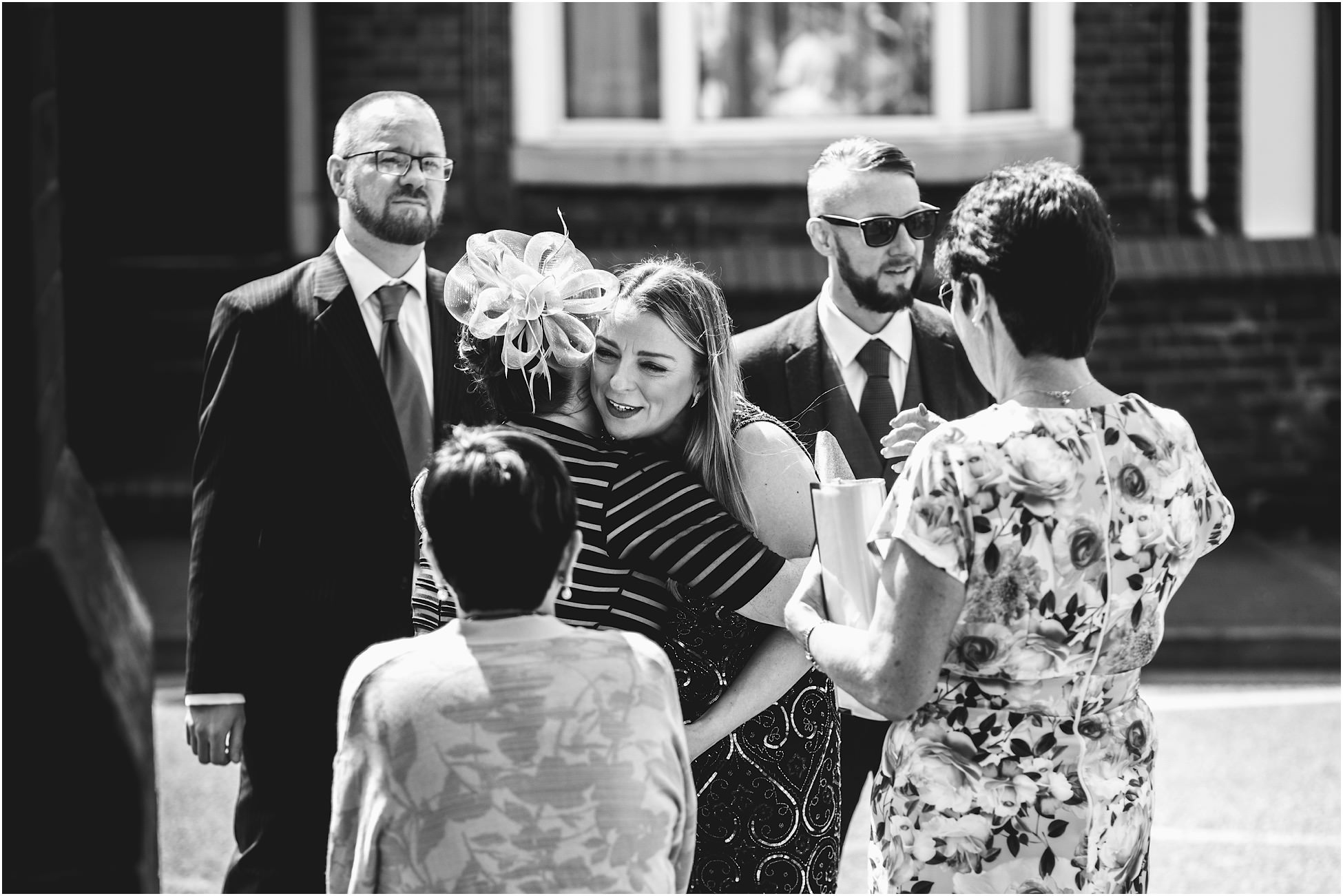 Wedding guests greeting each other outside church