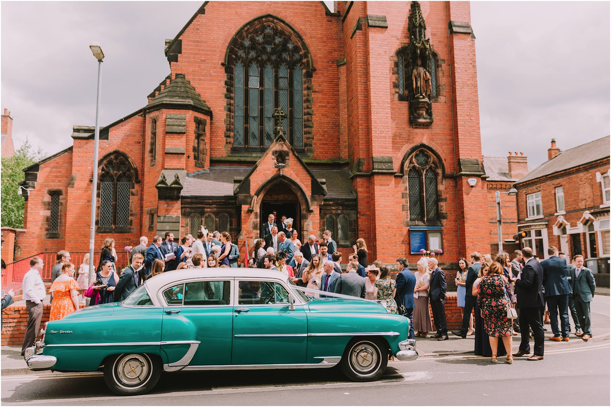 Wedding car and all wedding guests outside church at a Cheshire wedding
