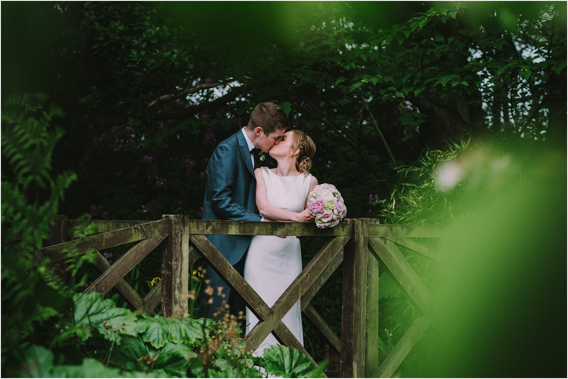 Bride and groom kissing during their Nunsmere Hall wedding