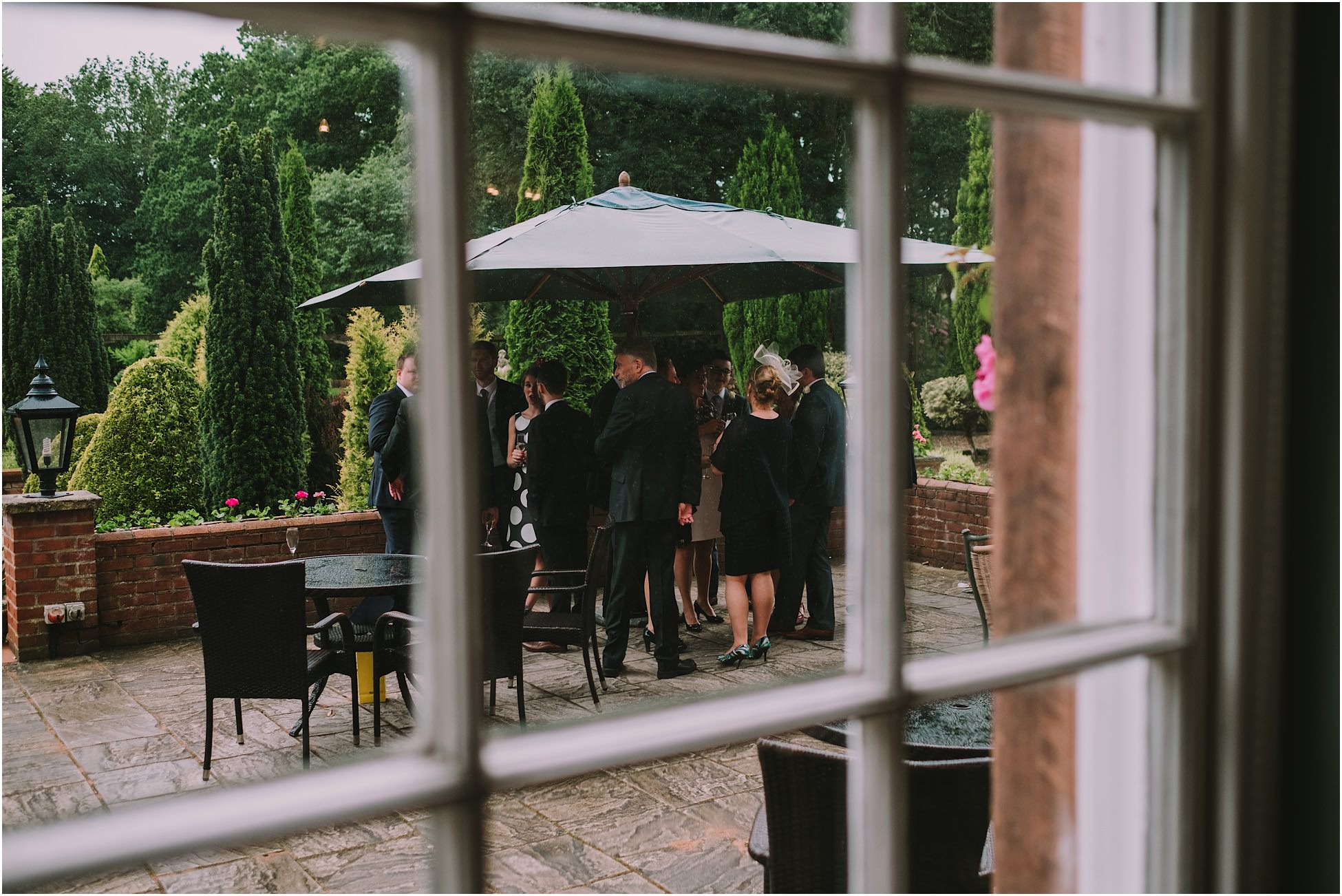 Wedding guests on the terrace at Nunsmere Hall