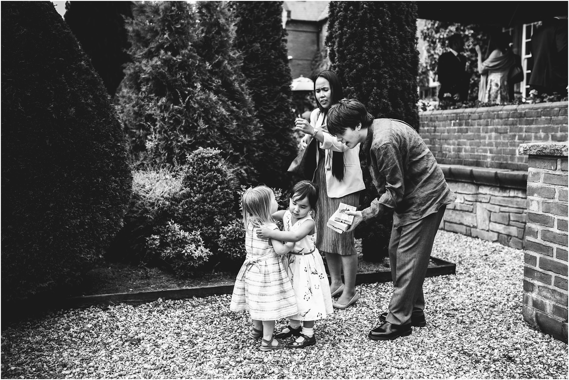 Children hugging during the wedding reception at Nunsmere Hall