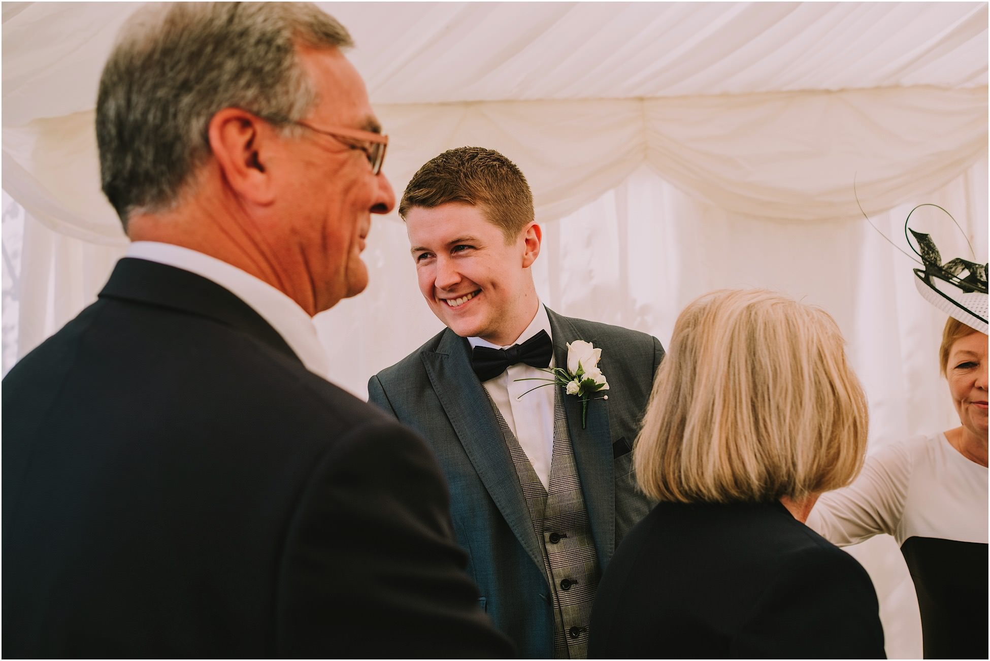 Groom speaking to the guests at a wedding reception