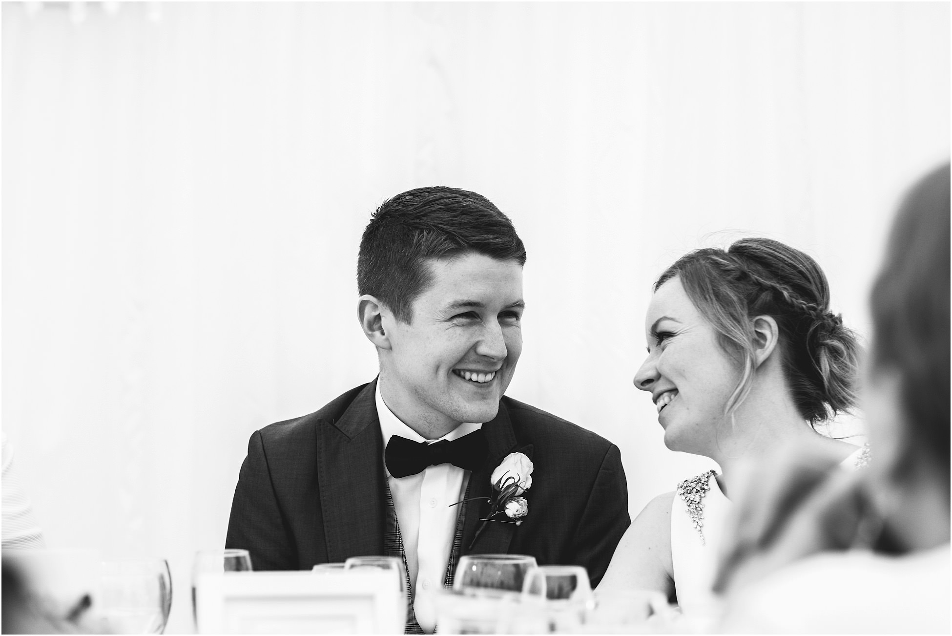 Bride and groom smiling at each other at their Nunsmere Hall wedding